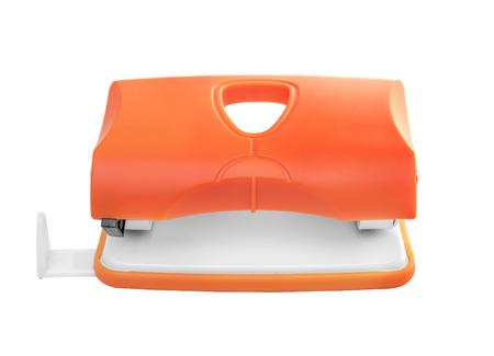 hole punch: Orange hole punch isolated on white background.