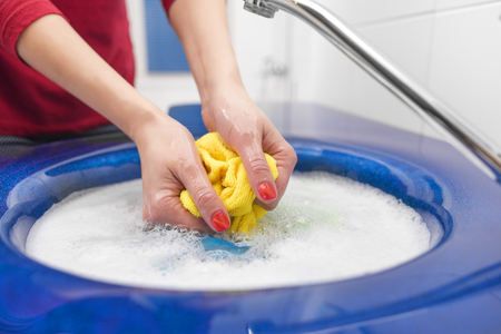 stain: Hand rag wash with the sink in a bathroom. Stock Photo