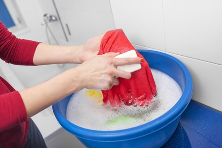 anti bacterial soap: Wash rag with soap and water in tazike. Stock Photo