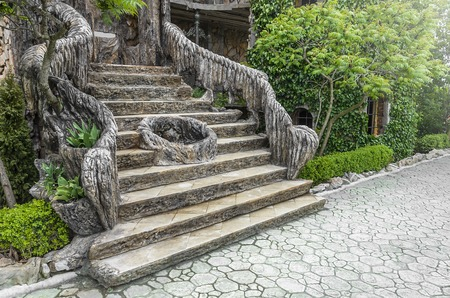 ascendant: Beautiful old decorated stair in a garden.