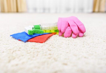 carpet stain: The carpet cleaner and tools lying on a carpet.