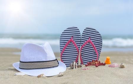 flipflops: Flip-flops and shells on the beach. Summer Still Life. Stock Photo