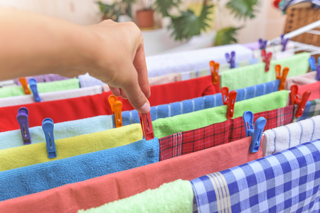 hangup: Hand hang on the clothespin clothing. Close-up.