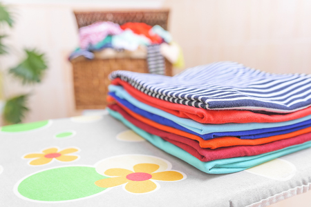 ironed: Ironed clothes on an ironing board. Close-up.