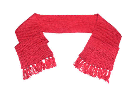 Red knitted scarf on a white background. Stock Photo