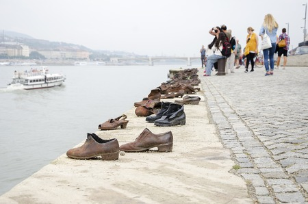 danuba: BUDAPEST, HUNGARY - SEPTEMBER 17: Shoes on the Danube Promenade - a monument to victims of the Holocaust, on September 17, 2016 in Budapest, Hungary.
