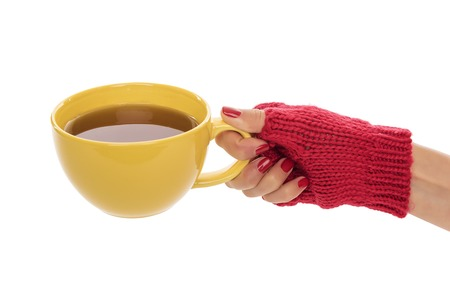 ingram: A cup of tea in female hands on a white background.
