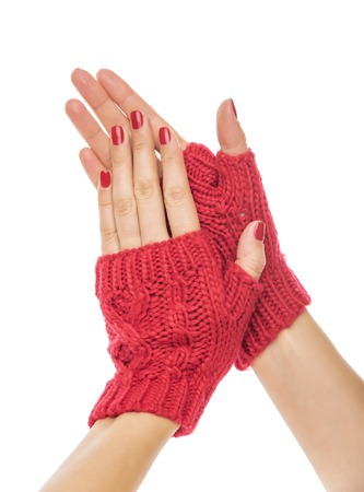 Female hands in mittens on a white background. Stock Photo