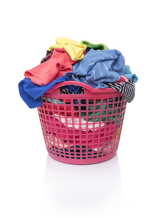 messy clothes: Basket of dirty laundry. Isolated on white background. Stock Photo
