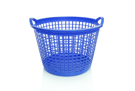 Plastic laundry basket. Isolated on white background. Фото со стока