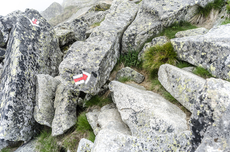 Marking a tourist route in the mountains.