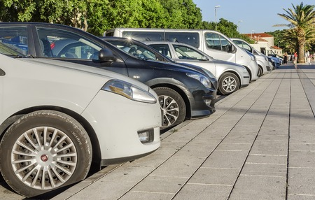 City parking in Makarska, Croatia. Editorial
