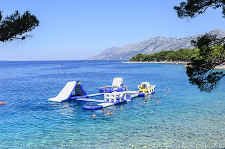 BRELA, CROATIA - 6 JULY, 2017: Inflatable slide on the sea for water activities.