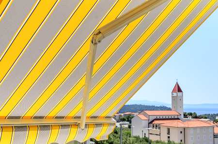 Awning over the balcony.