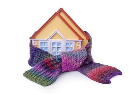 House is wrapped in scarf isolated on white background.