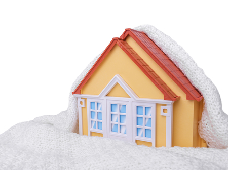 House wrapped with white woolen blanket. Isolated on white background.