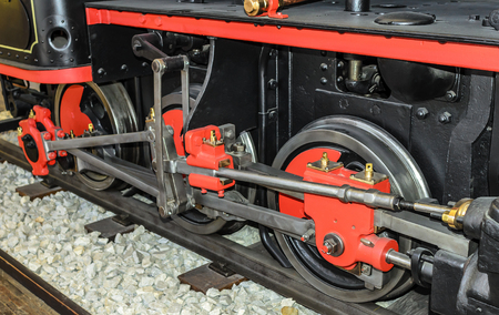 Locomotive wheels are close-up.