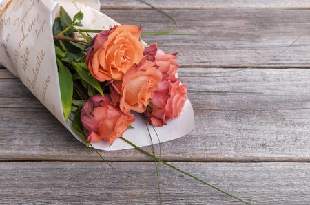 Bouquet of roses on wooden boards. Stock Photo