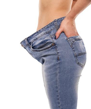 Frau zeigt , dass sie verloren zeigt . Große Jeans
