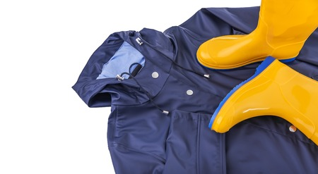 Rubber boots on a raincoat. Stock Photo