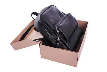 Leather backpack in a cardboard box. Stock Photo