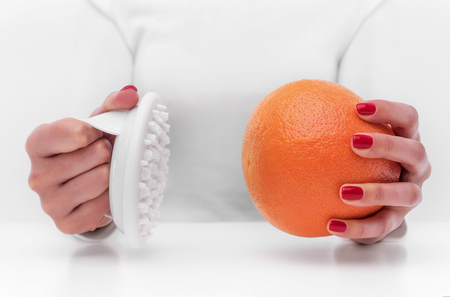 Anti-cellulite massager and orange. Banco de Imagens - 98175137