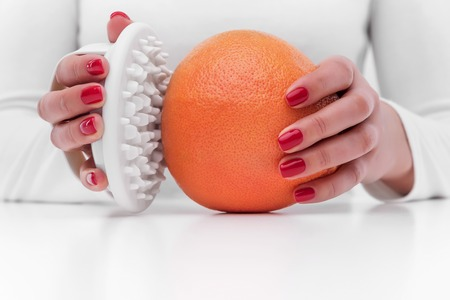 Anti-cellulite massager and orange.