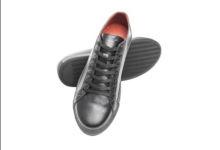 Black leather sneakers isolated on white background. Stock Photo