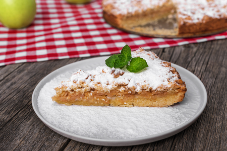 Slice of apple pie on a plate.