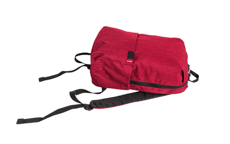 Red backpack lies, isolation on a white background.