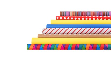 Rolls of multi-colored wrapping paper on a white background.