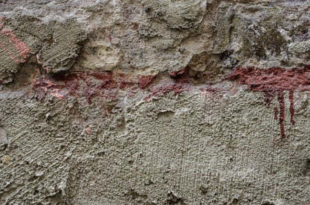 Old concrete wall relief. Well visible texture.