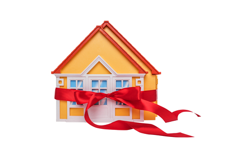 Layout of the house wrapped in a gift bow. Stock Photo