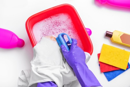 Clean the stain with a brush and detergent.