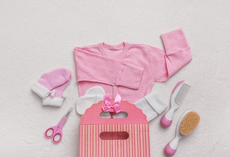 Set of clothes for the newborn and child care items.