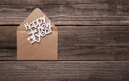 Inscription Happy New Year in an envelope. Stock Photo
