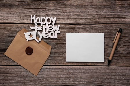 Happy New Year greeting cards. Composition on wooden boards. Stock Photo