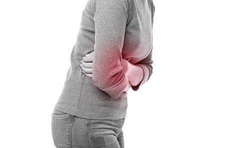 Figure d'une femme souffrant de douleur dans le corps sur fond blanc. Banque d'images