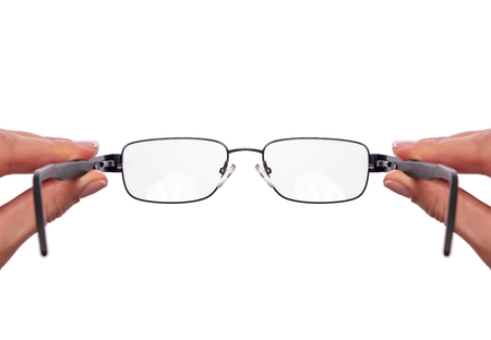 Glasses in a female hand on white background.