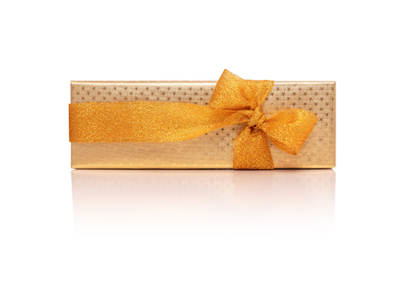 Golden gift box with ribbon isolated on a white. Stock Photo