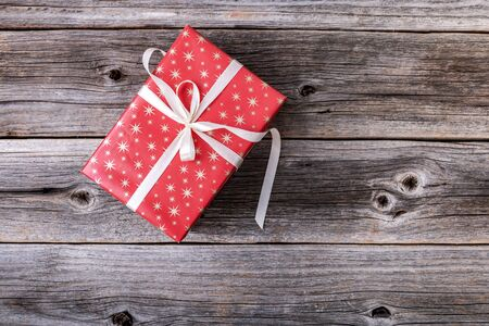Red gift box on wooden background. 스톡 콘텐츠