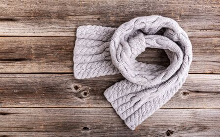 Winter scarf on a wooden background. 스톡 콘텐츠