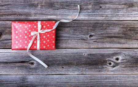 Red gift box on a wooden background. 스톡 콘텐츠