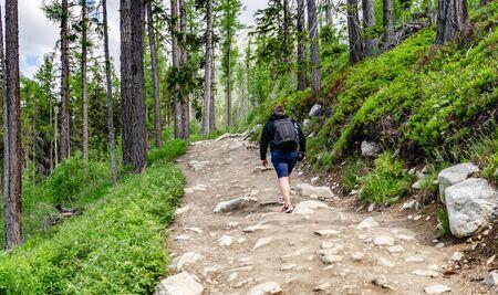 Tourists on mountain trails in Tatra Mountains, Slovakia.