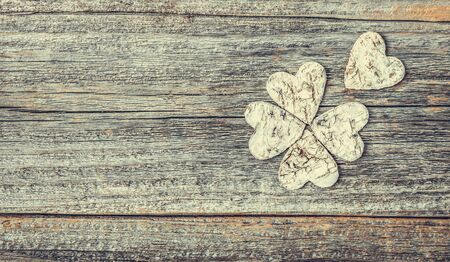 Four-leaf decorative on a wooden background