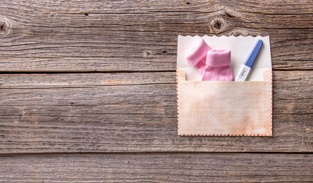 Pregnancy test as a still life on a wooden background.