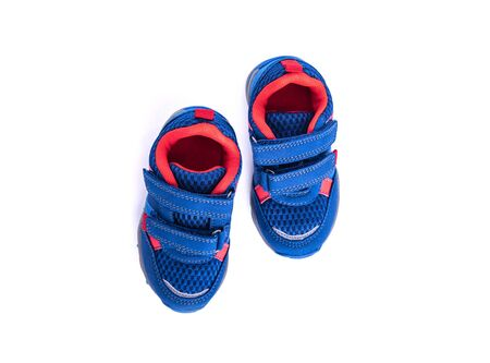 Kids sneakers isolated on white background.