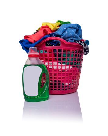 A basket with laundry on a white background. Stock fotó