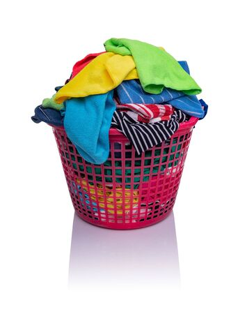A basket with laundry on a white background. Stock Photo