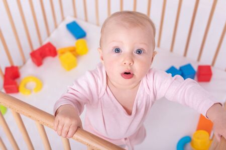 Baby girl at children's playpen. Banque d'images